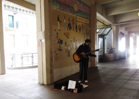 Guitarist at the Market by Tommia Wright